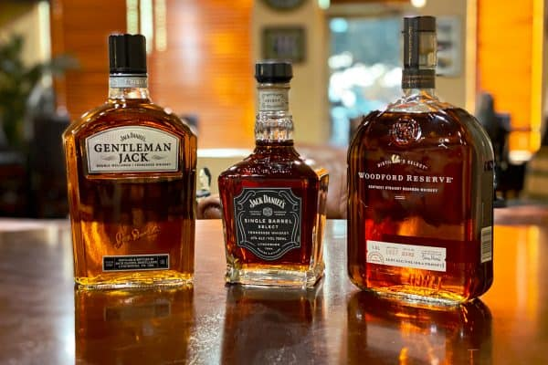 Bourbon Bottle Etching Event Photo - Shows 3 bottles of bourbon. Gentleman Jack, Jack Daniels Single Barrel, and Woodford Reserve